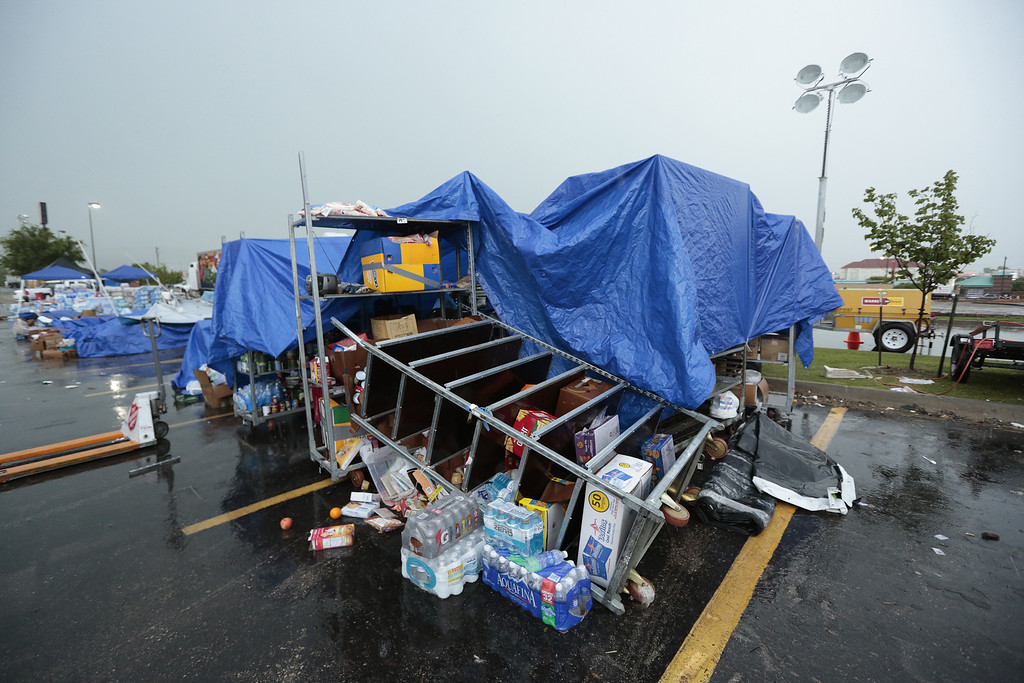 Description of . MOORE, OK -  MAY 23:   Supplies from the Salvation Army for tornado victims sit overturned and rain soaked from overnight rains May 23, 2013  in Moore, Oklahoma. The tornado of at least EF4 strength and up to two miles wide touched down May 20 killing at least 24 people and leaving behind extensive damage to homes and businesses. U.S. President Barack Obama promised federal aid to supplement state and local recovery efforts.    (Photo by Brett Deering/Getty Images)