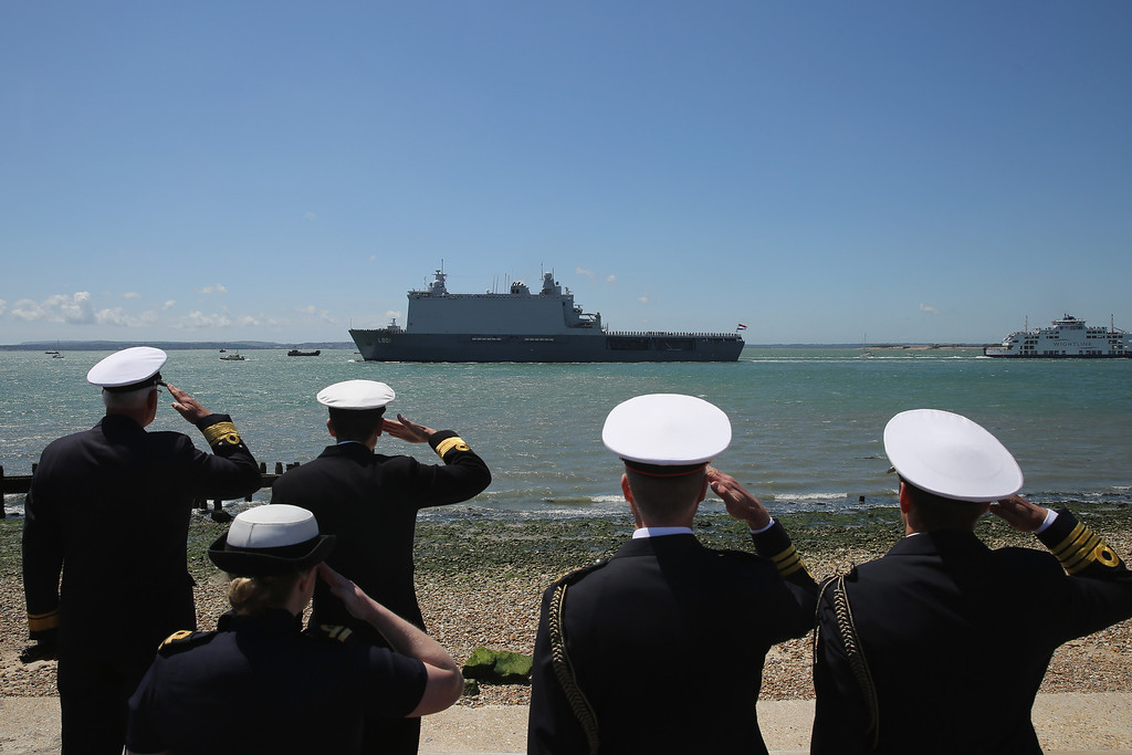 Description of . Dutch Naval Officers salute as the HNLMS Joan de Witte sails past Southsea Common during a commemoration of the D-Day landings on June 5, 2014 in Portsmouth, England. (Photo by Dan Kitwood/Getty Images)