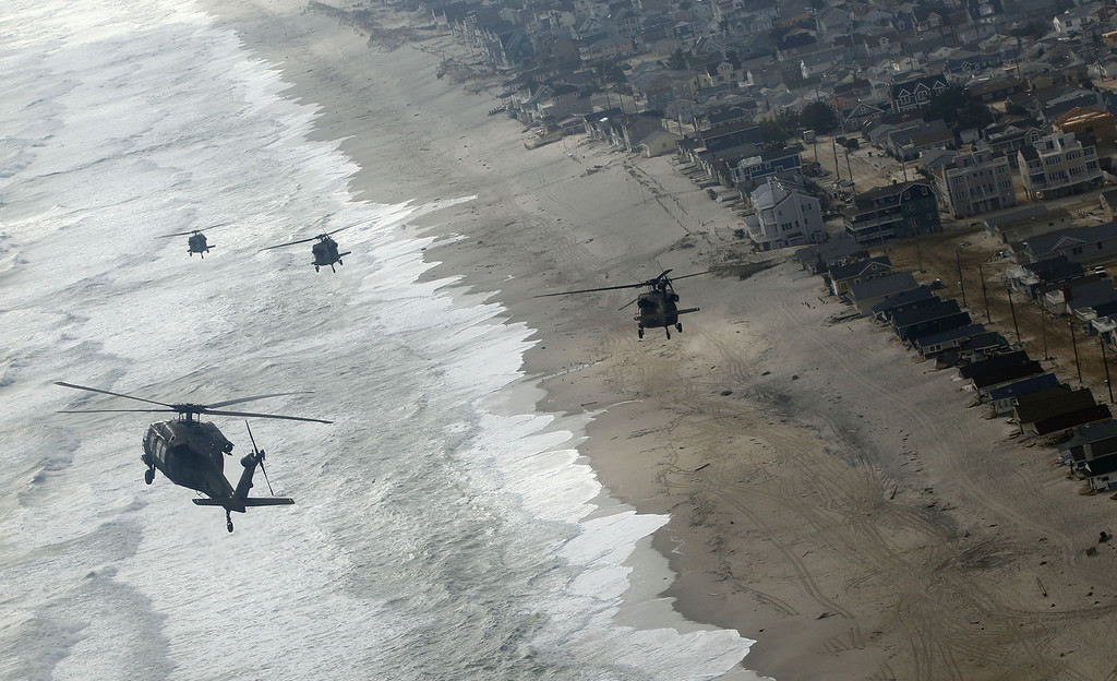 Description of . Four Air Force Black Hawk helicopters, one with Vice President Joe Biden onboard, approaches Seaside Park, N.J., Sunday, Nov. 18, 2012. The Vice President is in New Jersey to tour the damage and thank first responders from Superstorm Sandy. (AP Photo/Rich Schultz)