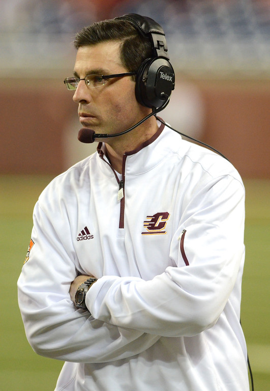 Description of . DETROIT, MI - DECEMBER 26:  Head Coach Dan Enos of the Central Michigan University Chippewas looks on during the first quarter of the Little Caesars Pizza Bowl against the Western Kentucky University Hilltoppers at Ford Field on December 26, 2012 in Detroit, Michigan.  (Photo by Mark A. Cunningham/Getty Images)