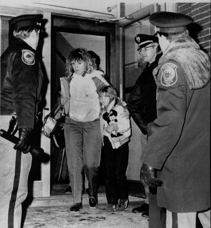 Description of . A third grade student of Christa McAuliffe leaves Kimball Elementary School with her mother after being reunited upon her return from Cape Canaveral after watching her teacher take-off on the ill rated space shuttle Challenger on late Jan. 28, 1986. Denver Post Library Archive