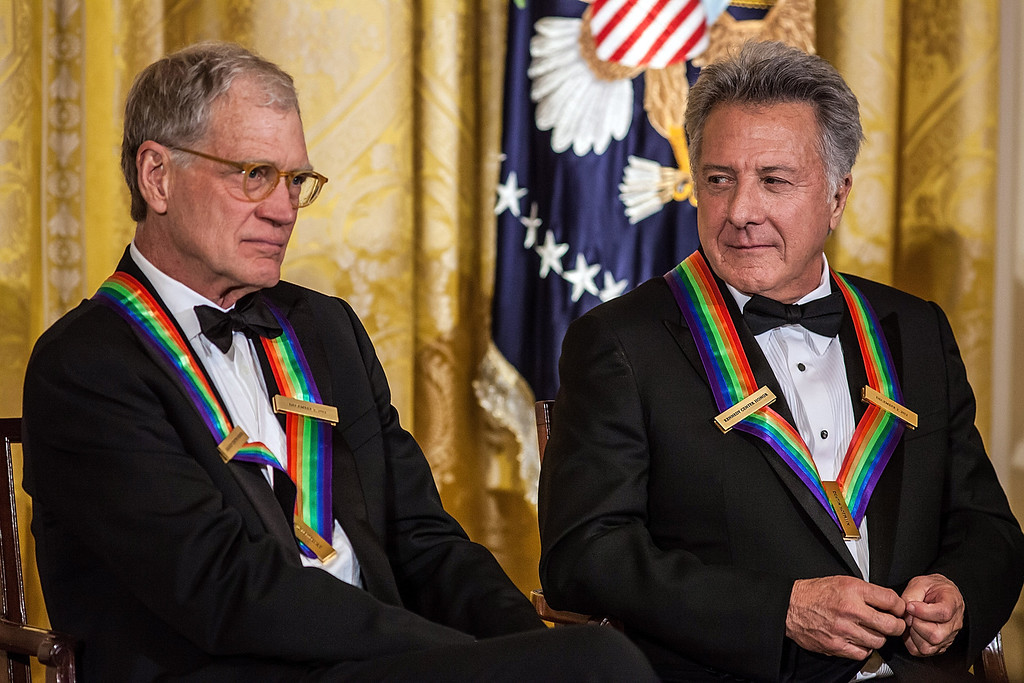 Description of . WASHINGTON - DECEMBER 2: (AFP OUT) Comedian David Letterman (L) and actor Dustin Hoffman attend the Kennedy Center Honors reception at the White House on December 2, 2012 in Washington, DC. The Kennedy Center Honors recognized seven individuals - Buddy Guy, Dustin Hoffman, David Letterman, Natalia Makarova, John Paul Jones, Jimmy Page, and Robert Plant - for their lifetime contributions to American culture through the performing arts. (Photo by Brendan Hoffman/Getty Images)