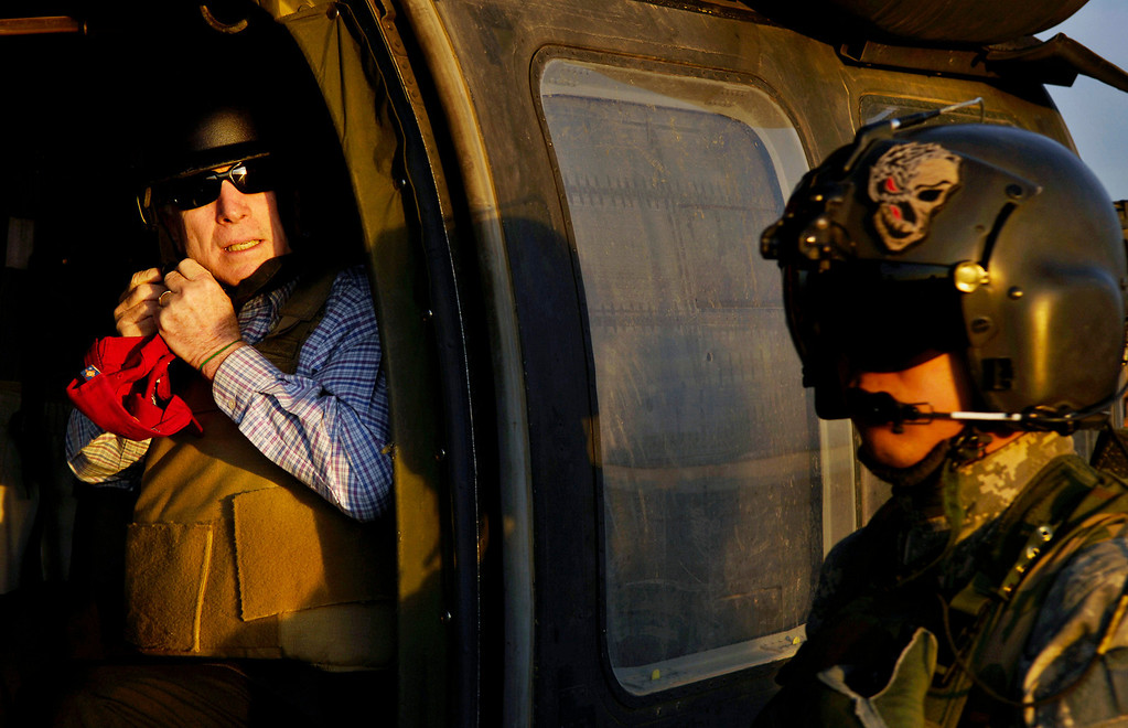 Description of . US Republican presidential candidate Senator John McCain (R-AZ) unbuckles his flight helmet as he arrives at Sather Air Base in Baghdad, March 16, 2008. Picture taken March 16, 2008.  REUTERS/U.S. Air Force/Tech. Sgt. Jeffrey Allen/Handout