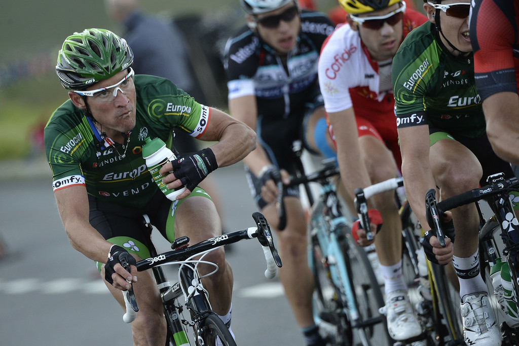 Description of . France's Thomas Voeckler rides in a breakaway during the 201 km second stage of the 101th edition of the Tour de France cycling race on July 6, 2014 between York and Sheffield, northern England.  AFP PHOTO / JEFF PACHOUDJEFF PACHOUD/AFP/Getty Images