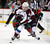 Colorado Avalanche left wing Gabriel Landeskog (92) brings the puck up the ice ahead of Minnesota Wild center Torrey Mitchell during the first period of their NHL ice hockey game in St. Paul, Minnesota, January 19, 2013. REUTERS/Eric Miller (UNITED STATES - Tags: SPORT ICE HOCKEY)