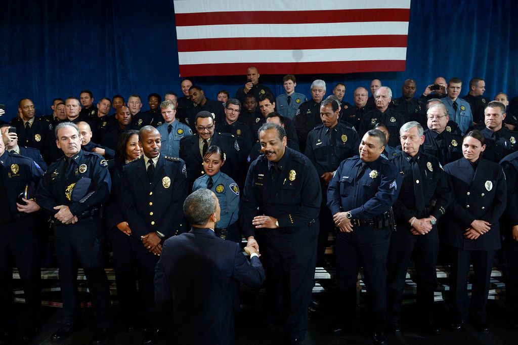 Description of . DENVER, CO. - APRIL 03: President Barack Obama greets law enforcement officers following a forum at the Denver Police Academy in Denver, CO April 03, 2013. In his first trip to Colorado since his re-election, President Obama urged Congress to act more like the state's Democratic-controlled legislature and quickly pass stronger gun-control laws. During the meeting with law enforcement officials and community leaders, Obama praised lawmakers and Gov. John Hickenlooper for passing some of the nation's strongest gun-control measures after the shootings in Aurora and at a Connecticut elementary school. (Photo By Craig F. Walker/The Denver Post)