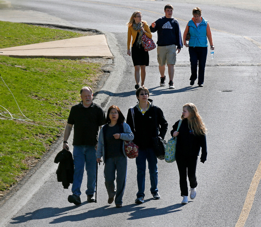 Description of . Students are escorted from the campus of the Franklin Regional School District after more then a dozen students were stabbed by a knife wielding suspect at nearby Franklin Regional High School on Wednesday, April 9, 2014, in Murrysville, Pa., near Pittsburgh. The suspect, a male student, was taken into custody and is being questioned. (AP Photo/Gene J. Puskar)