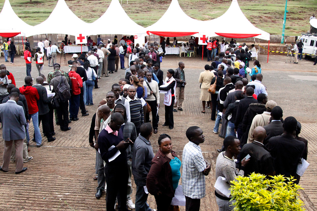 Description of . Kenyans line up to donate blood for those injured in Saturday's terrorist attack on a shopping mall, at Uhuru Park in Nairobi, Kenya, Monday, Sept. 23, 2013.  (AP Photo/Khalil Senosi)
