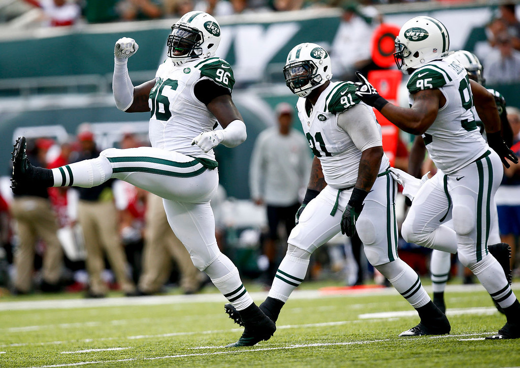 Description of . Muhammad Wilkerson #96 of the New York Jets celebrates a sack of Josh Freeman #5 of the Tampa Bay Buccaneers (not pictured)during their game at MetLife Stadium on September 8, 2013 in East Rutherford, New Jersey.  (Photo by Jeff Zelevansky/Getty Images)