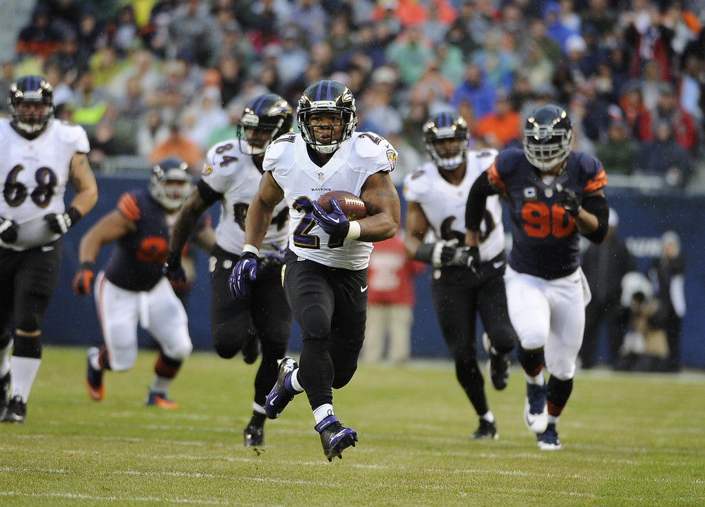 Description of . Ray Rice #27 of the Baltimore Ravens runs for a big gain against the Chicago Bears during the first quarter on November 17, 2013 at Soldier Field in Chicago, Illinois. (Photo by David Banks/Getty Images)