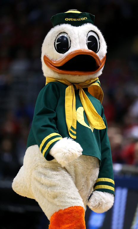 Description of . The Oregon Ducks mascot performs during the second round game of NCAA Basketball Tournament against the Brigham Young Cougars at BMO Harris Bradley Center on March 20, 2014 in Milwaukee, Wisconsin.  (Photo by Jonathan Daniel/Getty Images)