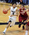 Askia Booker of Cu drives past Aaron Bright of Stanford during the second half of the January 24th, 2013 game in Boulder.