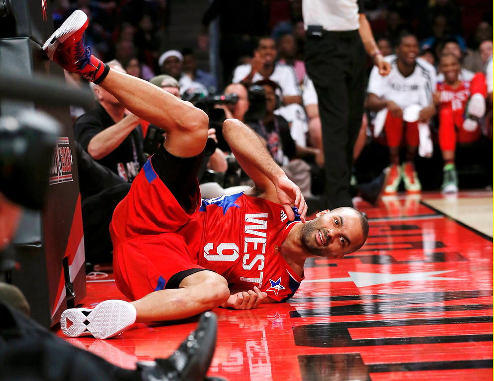 Description of . NBA All-Star Tony Parker of the San Antonio Spurs crashes to the court after making a diving pass during the NBA All-Star basketball game in Houston, Texas, February 17, 2013. REUTERS/Lucy Nicholson (UNITED STATES  - Tags: SPORT BASKETBALL)