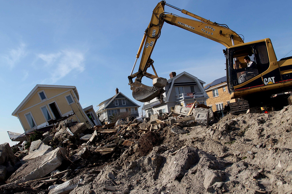 Description of . Clean up continues on the site of a demolished home on the Rockaway Peninsula in New York, Thursday, Nov. 29, 2012. Sandy damaged or destroyed  305,000 housing units in New York.   (AP Photo/Seth Wenig)