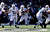 Andrew Luck #12 of the Indianapolis Colts is hit by Ray Lewis #52 of the Baltimore Ravens in the first quarter during the AFC Wild Card Playoff Game at M&T Bank Stadium on January 6, 2013 in Baltimore, Maryland.  (Photo by Rob Carr/Getty Images)