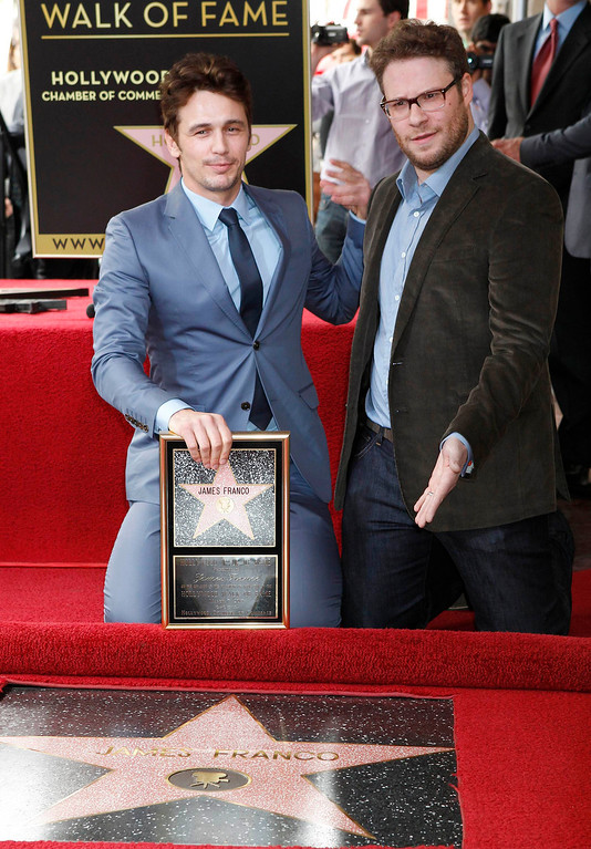 Description of . Actor James Franco (L) poses with his newly unveiled star on the Hollywood Walk of Fame, with actor Seth Rogen March 7, 2013. REUTERS/Fred Prouser