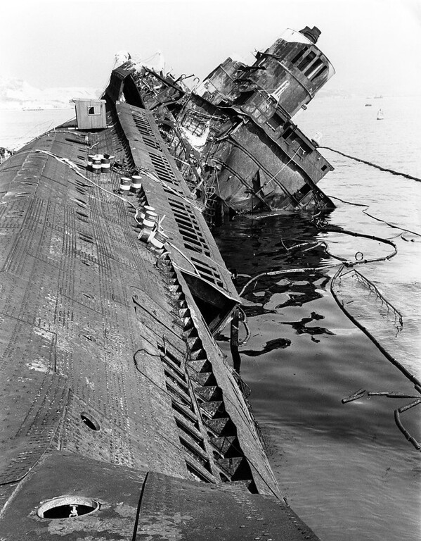 . A picture of the wreck of the former Queen Elizabeth taken from the stern in Hong Kong Harbor on Oct. 27, 1972.  On the left is the side of the ship, made from two-inch steel plating, which folded over with the heat of the fire. (AP Photo)