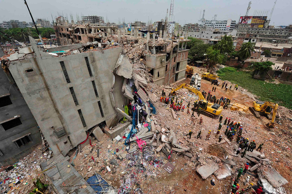 Description of . A view of rescue workers attempting to find survivors from the rubble of the collapsed Rana Plaza building in Savar, around 30 km (19 miles) outside Dhaka April 30, 2013. REUTERS/Khurshed Rinku