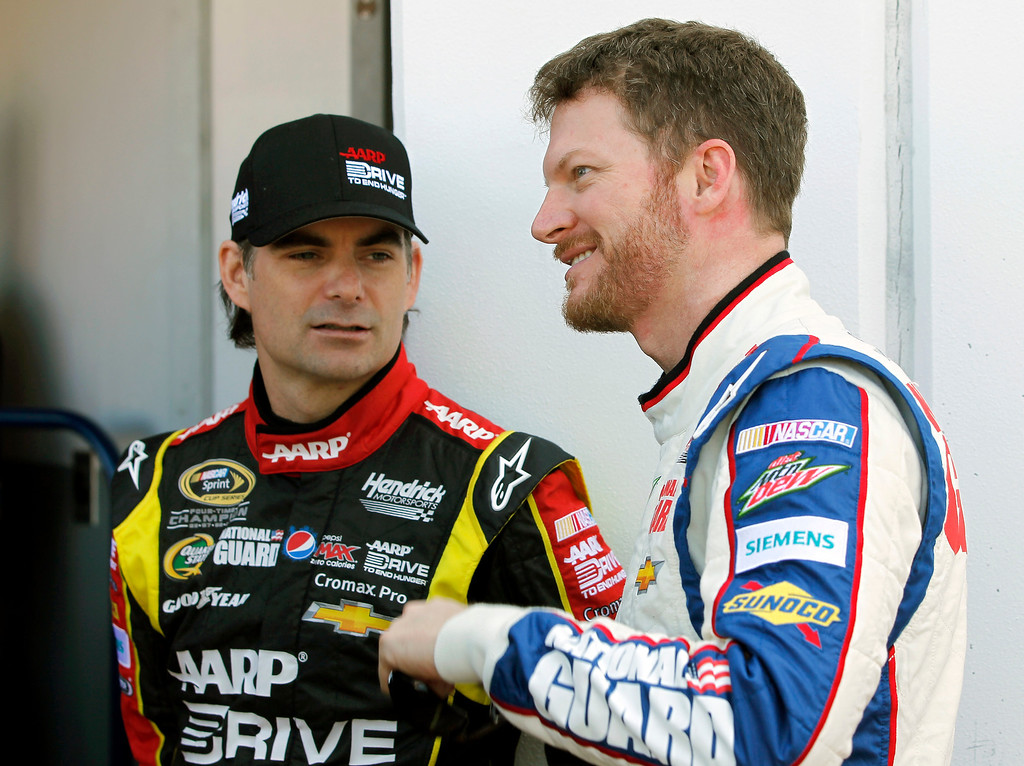 . Jeff Gordon, left, and Dale Earnhardt Jr., talk outside the garage during practice for the NASCAR Daytona 500 Sprint Cup Series auto race at Daytona International Speedway, Wednesday, Feb. 20, 2013, in Daytona Beach, Fla. (AP Photo/Terry Renna)