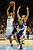Denver Nuggets point guard Andre Miller (24) skies for a rebound over Golden State Warriors point guard Stephen Curry (30) during the first half at the Pepsi Center on Sunday, January 13, 2013. AAron Ontiveroz, The Denver Post