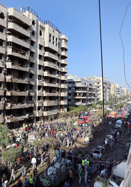 Description of . People gather at the site of a blast in Bir Hassan neighborhood in southern Beirut on November 19, 2013. AFP PHOTO/STR-/AFP/Getty Images