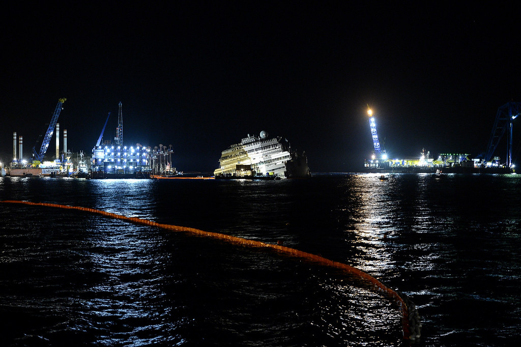 Description of . The wreck of Italy's Costa Concordia cruise ship begins to emerge from water on September 17, 2013 near the harbour of Giglio Porto. Salvage workers attempt to raise the cruise ship today and tonight, in the largest and most expensive maritime salvage operation in history, so-called