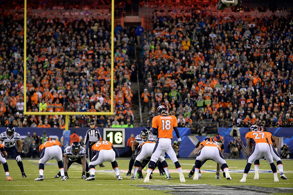 Description of . Denver Broncos quarterback Peyton Manning (18) running the offense during the second quarter. The Denver Broncos vs the Seattle Seahawks in Super Bowl XLVIII at MetLife Stadium in East Rutherford, New Jersey Sunday, February 2, 2014. (Photo by John Leyba/The Denver Post)