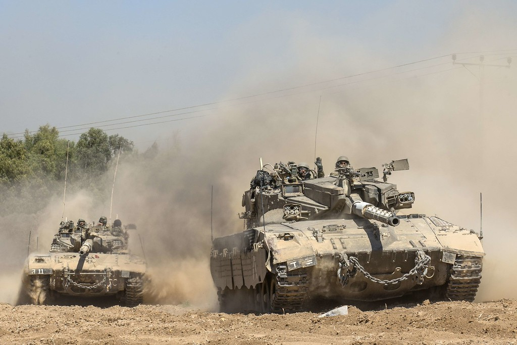 Description of . Israeli Merkava tanks roll to the southern Israeli border with the Gaza Strip, on August 1, 2014. Israeli forces in the southern Gaza Strip are searching for a missing soldier they fear may have been captured by militants at the start of a new ceasefire, the army said. AFP PHOTO / JACK GUEZ/AFP/Getty Images