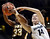 Colorado's Meagan Malcolm-Peck (14) fights for a rebound with Wyoming's Chaundra Sewell (33) during their NCAA college basketball game, Wednesday, Nov. 28, 2012, in Boulder, Colo. (AP Photo/The Daily Camera, Jeremy Papasso)