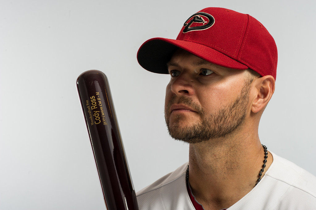 Description of . SCOTTSDALE, AZ - FEBRUARY 20: Cody Ross #7 of the Arizona Diamondbacks poses for a portrait on photo day at the Salt River Stadium at Talking Stick on February 20, 2013 in Scottsdale, Arizona. (Photo by Rob Tringali/Getty Images)