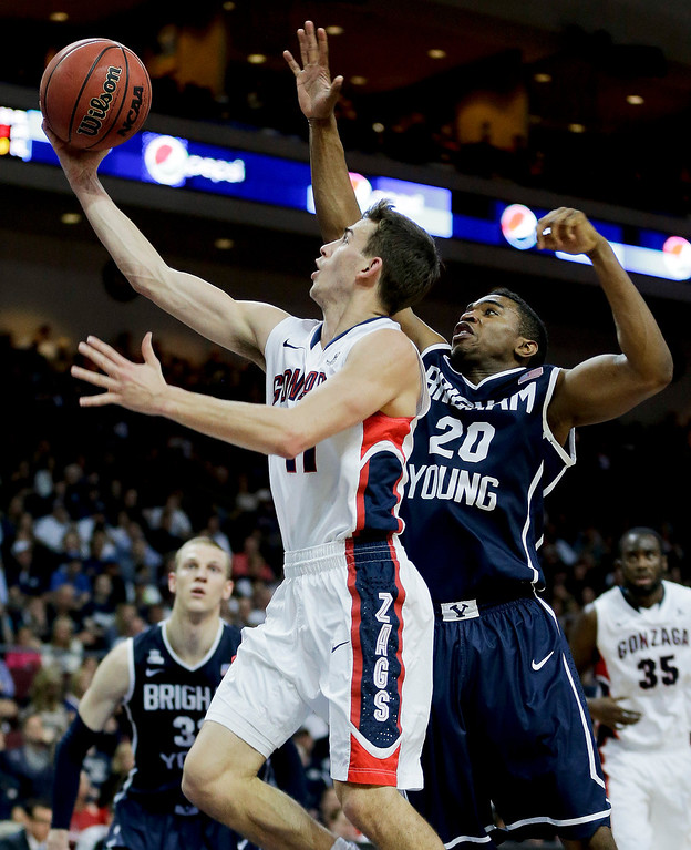Description of . Gonzaga's David Stockton, left, puts up a shot against BYU's Anson Winder in the first half of the NCAA West Coast Conference tournament championship college basketball game, Tuesday, March 11, 2014, in Las Vegas. (AP Photo/Julie Jacobson)
