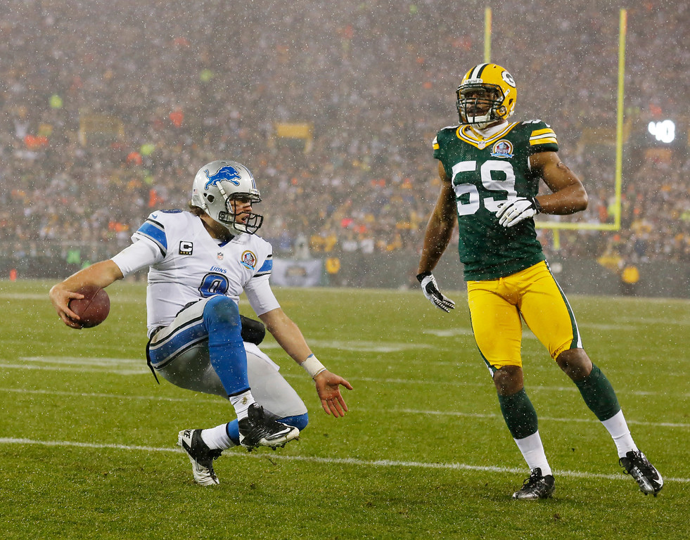 Description of . Detroit Lions' Matthew Stafford reacts after running for a touchdown against Green Bay Packers' Brad Jones (59) during the first half of an NFL football game Sunday, Dec. 9, 2012, in Green Bay, Wis. (AP Photo/Jeffrey Phelps)