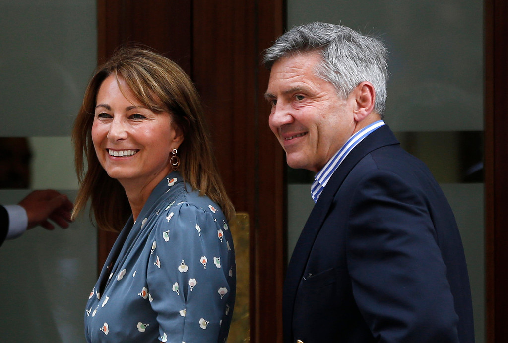 Description of . Carole and Michael Middleton, the parents of Kate, Duchess of Cambridge, smile as they arrive at St. Mary\'s Hospital\'s exclusive Lindo Wing in London on Tuesday, July 23, 2013, where the Duchess gave birth Monday. The royal couple are expected to head to Kensington Palace from the hospital with their newborn son, the third in line to the British throne. (AP Photo/Lefteris Pitarakis)