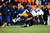 Denver Broncos defensive back Tony Carter (32) takes down Baltimore Ravens wide receiver Jacoby Jones (12). The Denver Broncos vs Baltimore Ravens AFC Divisional playoff game at Sports Authority Field Saturday January 12, 2013. (Photo by AAron  Ontiveroz,/The Denver Post)