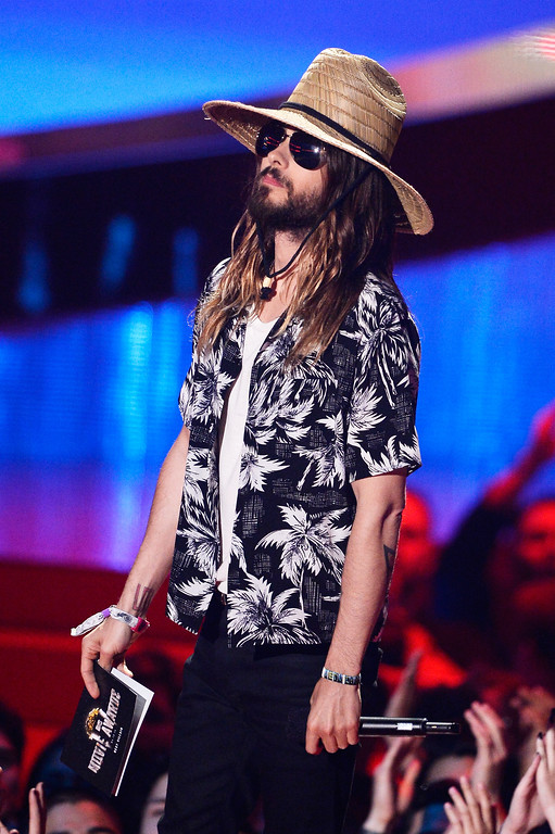 Description of . Actor Jared Leto speaks onstage at the 2014 MTV Movie Awards at Nokia Theatre L.A. Live on April 13, 2014 in Los Angeles, California.  (Photo by Kevork Djansezian/Getty Images for MTV)