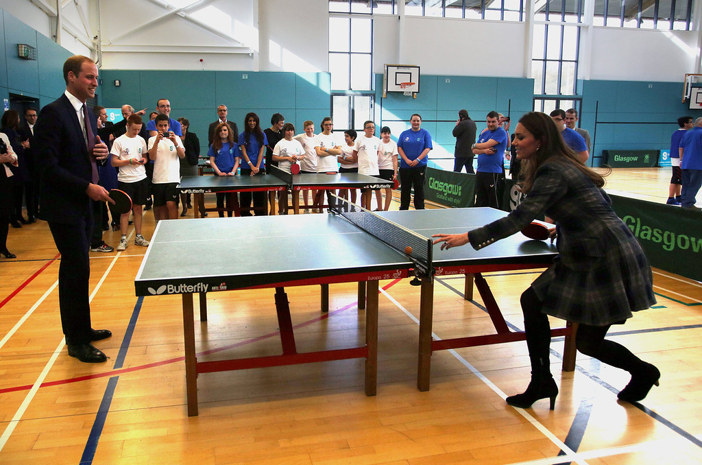 Description of . Britain\'s Catherine, Duchess of Cambridge, plays table tennis against Britain\'s Prince William, Duke of Cambridge, during a visit to the Donald Dewer Leisure centre in Glasgow, Scotland on April 4, 2013. The Duke and Duchess of Cambridge, known as the Earl and Countess of Strathearn in Scotland, visited the Donald Dewer Leisure  to launch a new Scottish project for their foundation.  DAVID CHESKIN/AFP/Getty Images