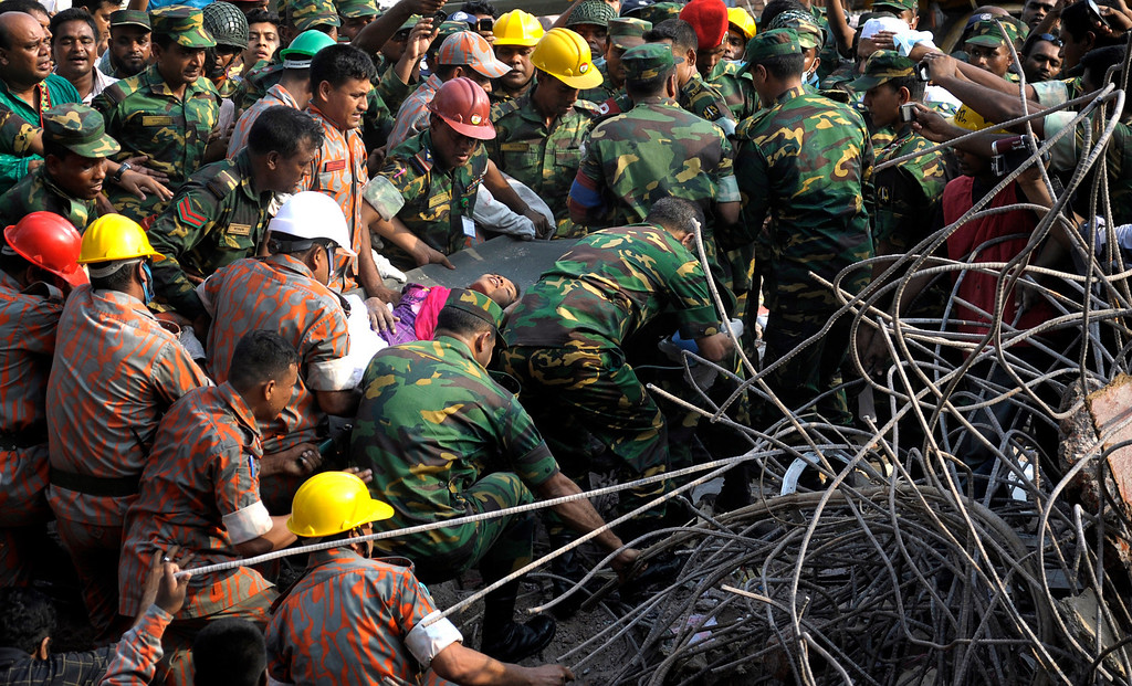 Description of . Rescuers carry survivor Reshma Begum from the rubble of a building that collapsed in Savar, near Dhaka, Bangladesh, Friday, May 10, 2013. (AP Photo/Rahul Talukder)
