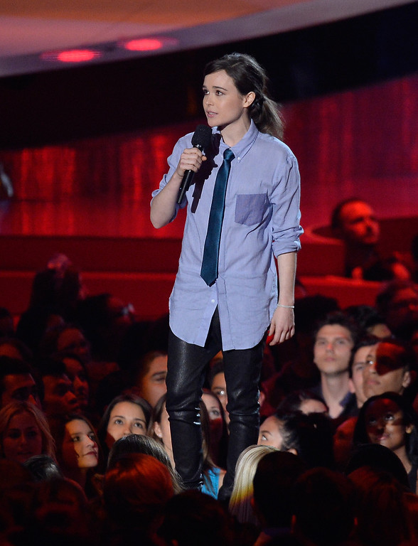 Description of . Actress Ellen Page speaks onstage at the 2014 MTV Movie Awards at Nokia Theatre L.A. Live on April 13, 2014 in Los Angeles, California.  (Photo by Kevork Djansezian/Getty Images for MTV)