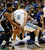 Memphis Grizzlies forward Rudy Gay (L) tries to get the ball from Denver Nuggets forward Danilo Gallinari (8) in the third quarter of their NBA basketball game in Denver December 14, 2012.   REUTERS/Rick Wilking