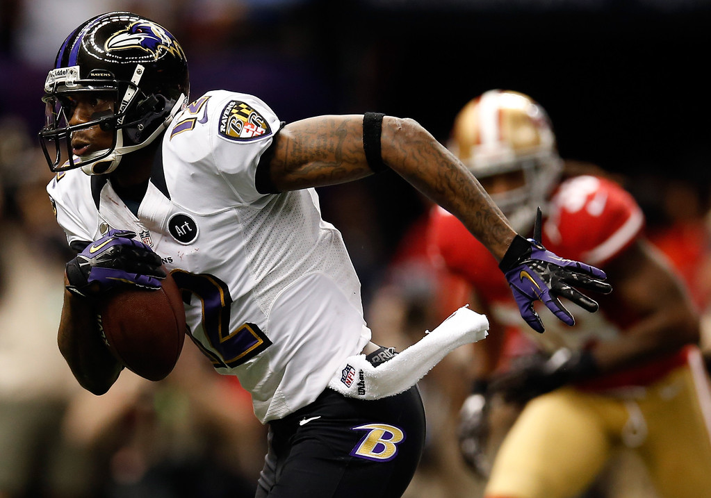 Description of . Jacoby Jones #12 of the Baltimore Ravens runs with the ball for a 56 yard touchdown against the San Francisco 49ers in the second quarter during Super Bowl XLVII at the Mercedes-Benz Superdome on February 3, 2013 in New Orleans, Louisiana.  (Photo by Chris Graythen/Getty Images)