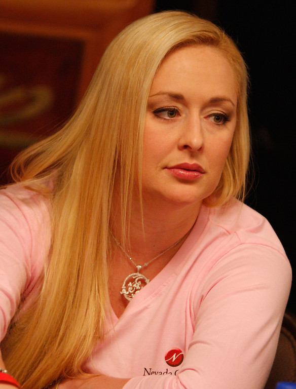 Description of . Singer Mindy McCready of the Queens of Heart poker team participates in the Ladies No-Limit Hold 'em poker tournament at the World Series of Poker at the Rio Hotel & Casino June 8, 2008 in Las Vegas, Nevada. A portion of the proceeds from the team will benefit the Nevada Cancer Institute. (Photo by Angela Weiss/Getty Images)