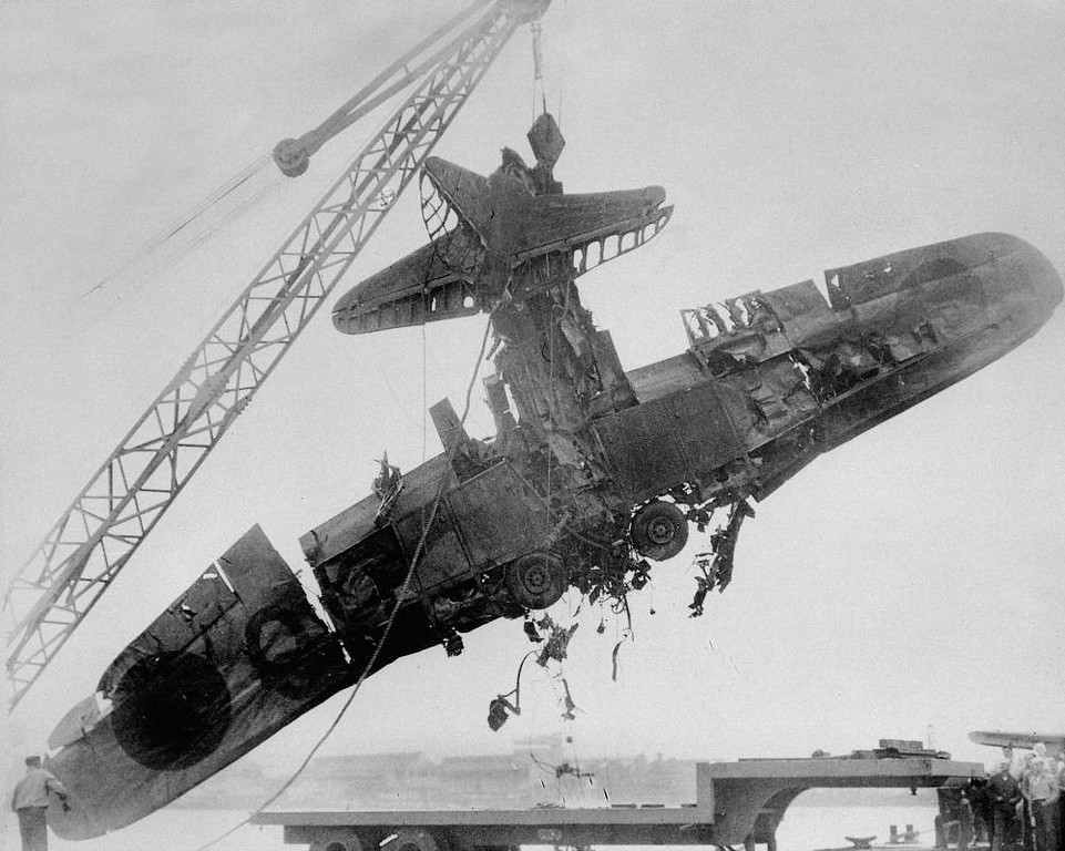 Description of . Wreckage, identified by the U.S. Navy as a Japanese torpedo plane , was salvaged from the bottom of Pearl Harbor following the surprise attack Dec. 7, 1941. (AP Photo)