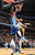 Denver Nuggets forward Andre Iguodala (L) dunks over Memphis Grizzlies center Marc Gasol (33), of Spain, during the second half of their NBA basketball game in Memphis, Tennessee December 29, 2012. The Grizzlies defeated the Nuggets 81-72.   REUTERS/Nikki Boertman