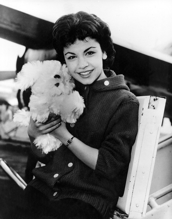 Description of . Walt Disney studio's new star, 16-year-old  Annette Funicello, poses with her Shaggy Dog doll, at Idlewild Airport in New York, on March 24, 1959.  (AP Photo)