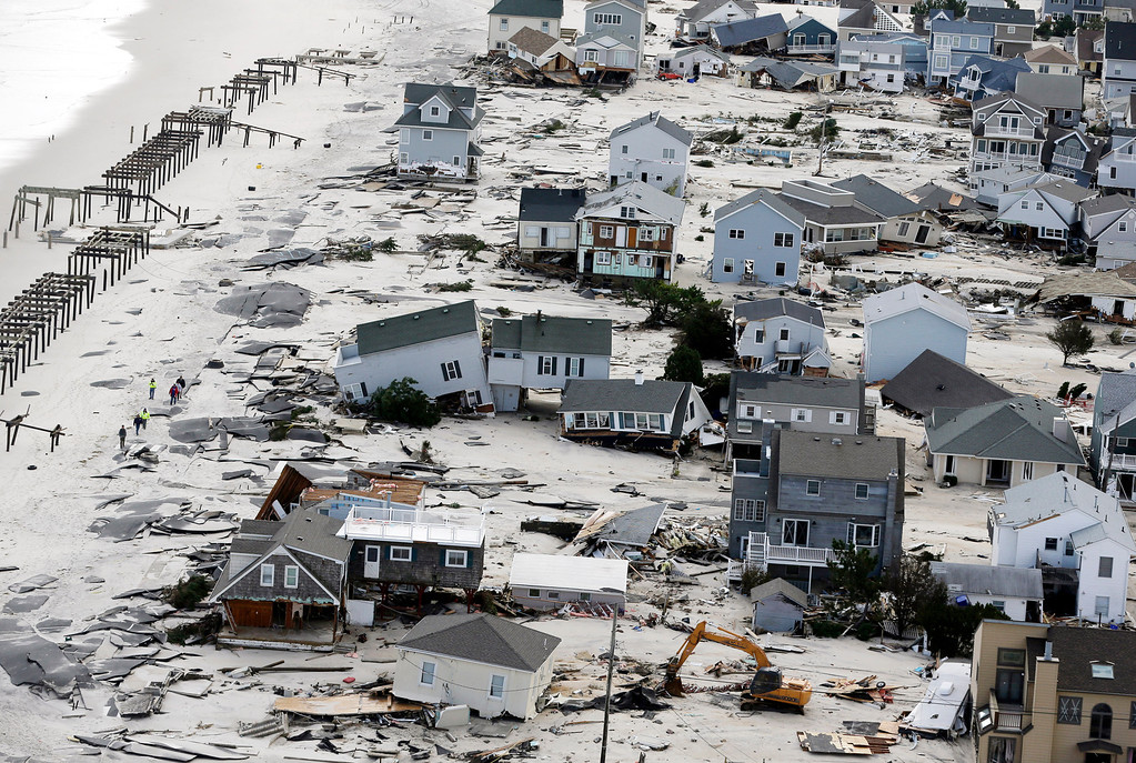 Description of . This Oct. 31, 2012 aerial file photo shows destruction in the wake of Superstorm Sandy in Seaside Heights, N.J.   (AP Photo/Mike Groll, File)