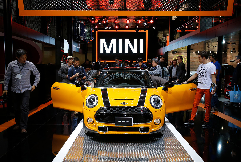 Description of . A new Mini is displayed at the media preview for the Tokyo Motor Show at Tokyo Big Sight in Tokyo, Wednesday, Nov. 20, 2013. The biannual exhibition of vehicles in Japan runs for the public from Saturday, Nov. 23 through Dec. 1. (AP Photo/Shuji Kajiyama)