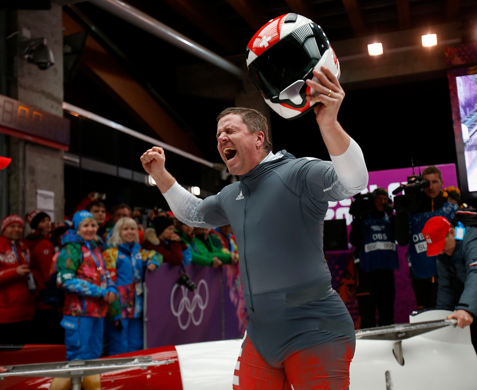 Description of . Switzerland-1 driver Beat Hefti celebrates following their Heat 4 run for Two-man Bobsleigh at the Sliding Center Sanki for the 2014 Winter Olympics in Krasnaya Polyana, Russia on Monday, Feb. 17, 2014.  The would win the silver medal.  (Nhat V. Meyer/Bay Area News Group)