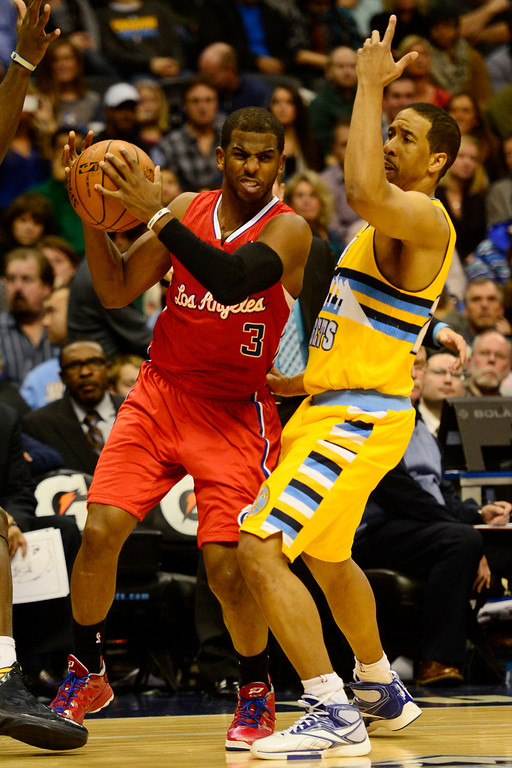Description of . Denver Nuggets point guard Andre Miller (24) pressures Los Angeles Clippers point guard Chris Paul (3) during the second half of the Nugget's 92-78 win at the Pepsi Center on Tuesday, January 1, 2013. AAron Ontiveroz, The Denver Post