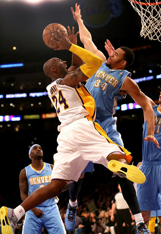 Description of . Kobe Bryant #24 of the Los Angeles Lakers goes up for a shot against JaVale McGee #34 of the Denver Nuggets at Staples Center on January 6, 2013 in Los Angeles, California.   (Photo by Stephen Dunn/Getty Images)