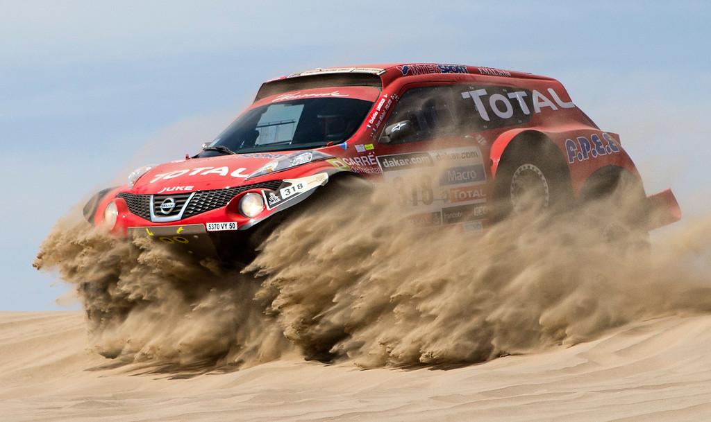 Description of . Christian Lavieille and co-driver Jean-Michel Polato of France compete in the 1st stage of the 2013 Dakar Rally near Pisco, Peru, Saturday, Jan. 5, 2013. The race finishes in Santiago, Chile, on Jan. 20. (AP Photo/Victor R. Caivano)